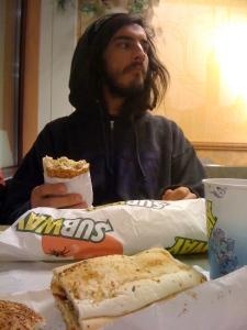 Marc enjoys his subway sandwich